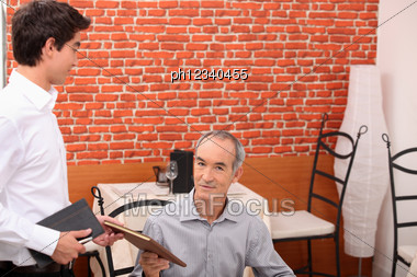 Customer Ordering In A Restaurant Stock Photo