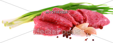 Cut Of Beef Steak With Garlic Slice, Onion And Laurel. Isolated Stock Photo