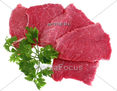 Cut Of Beef Steak With Green Leaf. Isolated Stock Photo