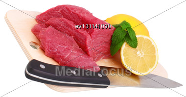 Cut Of Beef Steak, Knife With Lemon Slice. Isolated Stock Photo