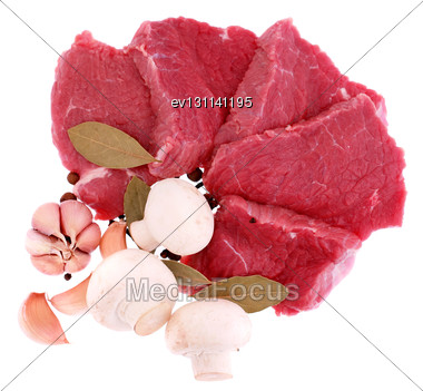 Cut Of Beef Steak With Laurel, Onion, Garlic And Flavouring. Isolated Stock Photo