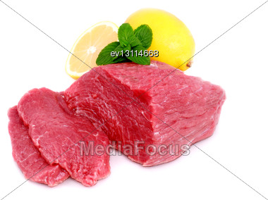 Cut Of Beef Steak With Lemon Slice. Isolated Stock Photo