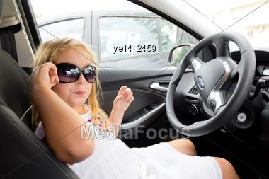 Cute Girl Driving Car In Sun Glasses Stock Photo