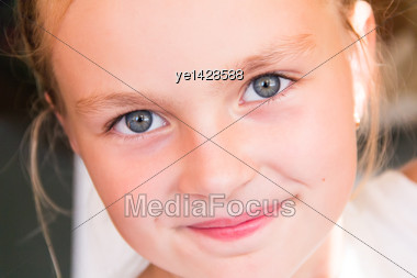 Cute Girl With Big Blue Eyes Stock Photo
