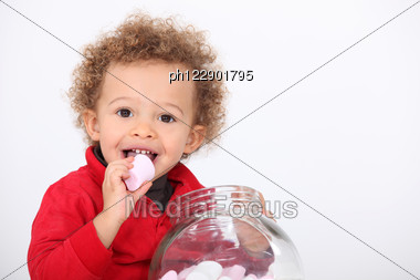 images of Kid Eating Marshmallow Stock Photo Ph122901795 Royalty Free