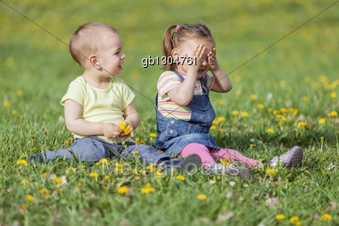 Cute kids at the spring field Stock Photo