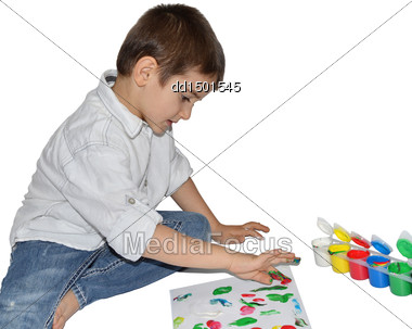 Cute Little Boy Paints With Her Fingers With Different Color Paint Stock Photo