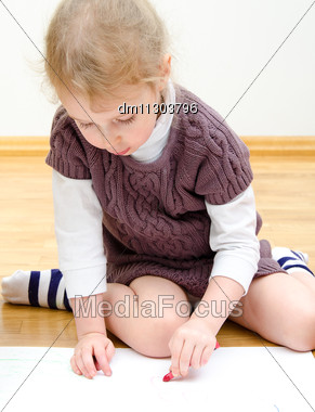 Cute Little Girl Drawing With Pencil Stock Photo