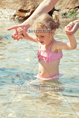 Cute Little Girl Having Fun In The Sea Stock Photo