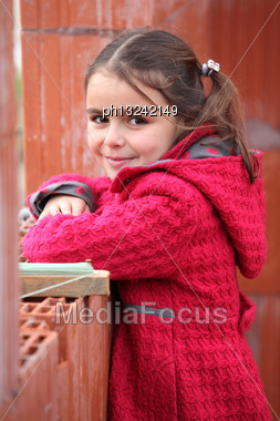 Cute Little Girl Wearing A Red Coat Stock Photo
