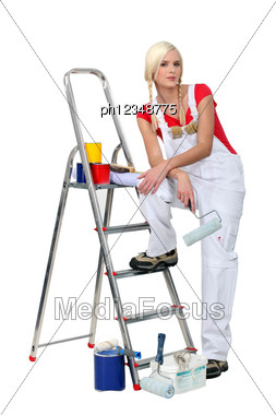 Cute Woman Painting And Decorating Stock Photo