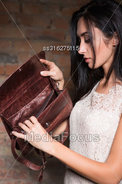 Cute Young Brunette Looking Something In Her Handbag Stock Photo