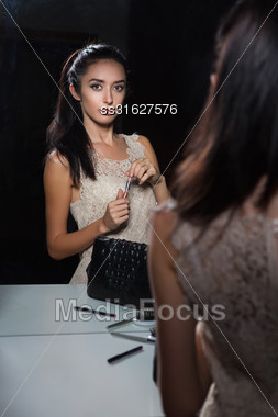 Cute Young Brunette Posing Near The Mirror Stock Photo