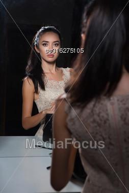 Cute Young Woman Posing Near The Mirror Stock Photo
