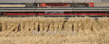 Cutters On Combine Harvester As It Harvests Wheat Stock Photo