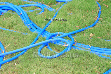 Cyan Water Pipe On The Green Grass Stock Photo