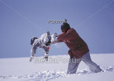 Dad and Child Playing in Snow Stock Photo