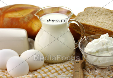 Dairy Products And Fresh Eggs In Glass Containers Stock Photo