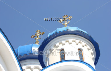 Dark Blue Church Domes Against The Blue Sky And Gold Crosses Nearby Stock Photo