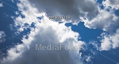 Dark Blue Sky With Cumulus Clouds Stock Photo