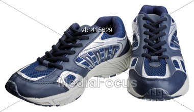 Dark Blue Sneakers, Isolated On A White Background Stock Photo
