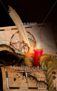 Dark Image Old Map, A Candle And The Rope Inkwell Stock Photo