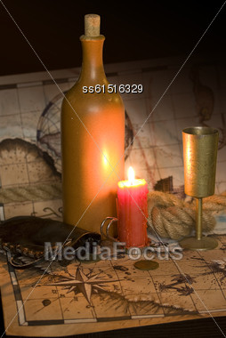 Dark Image Old Map, A Candle And The Rope And Bottle Stock Photo