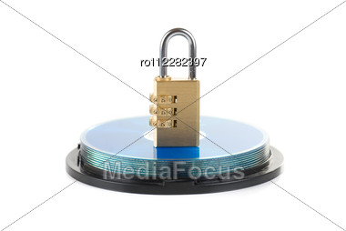 Data Security Concept: Silver CD/DVD With Combination Lock Stock Photo