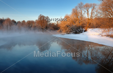 Dawn Frosty Day In February, The Fog And Sun Stock Photo