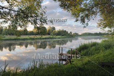 Dawn On The River Vilija, Belarus. The Sky With Clouds, The First Rays Of The Sun Stock Photo