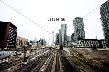 Daytime Photos Of Toronto Ontario Buildings Downtown Go Train And Tracks Stock Photo