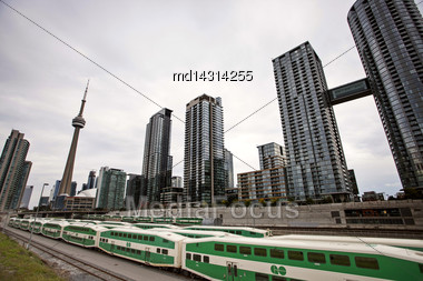 Daytime Photos Of Toronto Ontario Buildings Downtown Go Train And Tracks Stock Photo