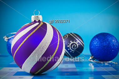 Decorative Christmas Baubles Over A Blue Background Stock Photo