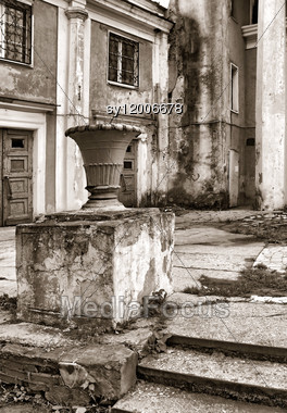Decorative Urn Near Old Buildings Stock Photo