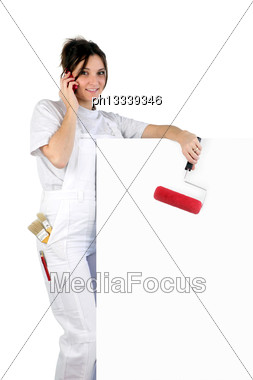 Decorator With A Blank Board And Paint Roller Stock Photo