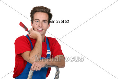 Decorator On A Stepladder Stock Photo