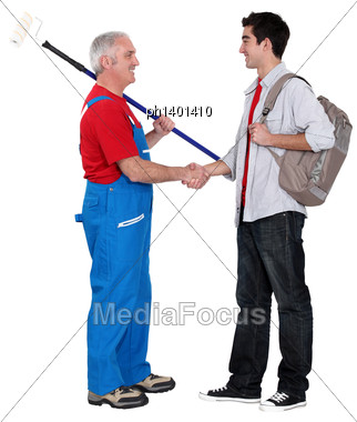 Decorator Welcoming A New Apprentice Stock Photo