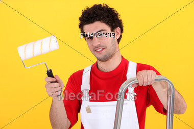 Decorator With A Paint Roller Stock Photo