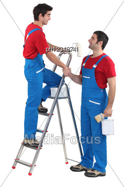 Decorators Shaking Hands Stock Photo