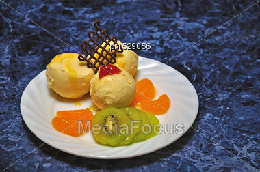 Dessert Of Fruit Salad And Icecream Served On A White China Plate Stock Photo