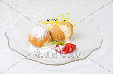 Dessert Of Ice-cream At Biscuit With Strawberry And Caramel Stock Photo