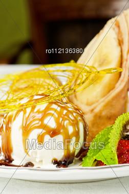 Dessert Of Pancake With Banana, Ice-cream, Caramel, Strawberry And Mint Stock Photo