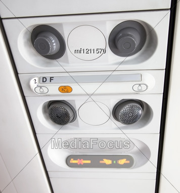 Detail Of Airplan Interior Salon. Overhead Buttons Stock Photo