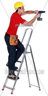 Determined Tradesman Using A Power Tool Stock Photo