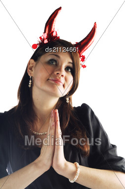 Devil-woman - Cute Young Pretty Girl In Black Dress With Red Horns Stock Photo