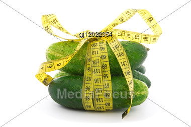 Diet Concept. Cucumbers With Yellow Measure Tape Stock Photo