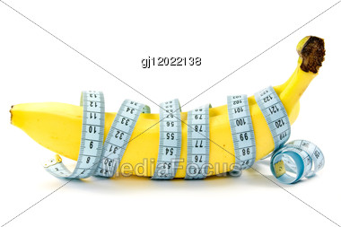 Diet And Nutrition. Bananas Wrapped With Measuring Tape Stock Photo