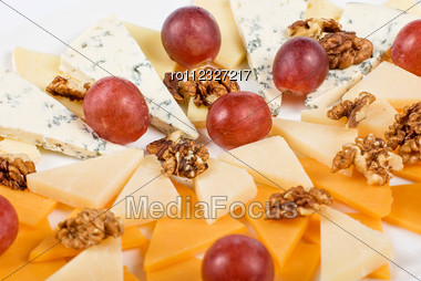 Different Cheese And Grapes Close Up Composition Stock Photo
