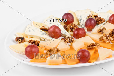 Different Cheese And Grapes And Nuts Close Up Composition Stock Photo