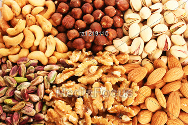 Different Nuts As A Background. Stock Photo